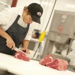 Lepp Farm 0226 man cutting meat