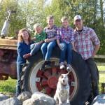 Randriso family photo by tractor 2013