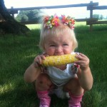 Sparkes girl eating corn image