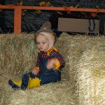 pumpkin festival - kid sitting on hay bales - cute PA214564 copy